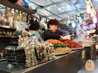 A common sight in Gwangjang Market. Just sit down and use your fingers to communicate!